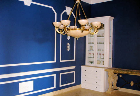 Newly painted blue walls with white trim