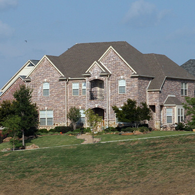 Exterior of brick home in Crowley by Platinum Painting