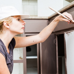 woman painting cabinets
