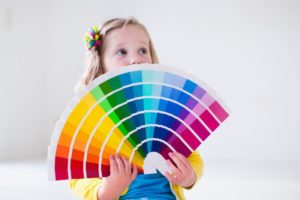 child holding paint cards