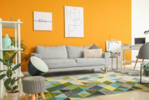 decorated, bold living room with yellow walls