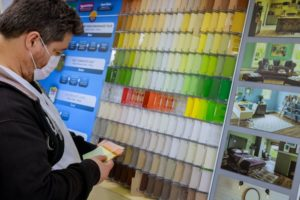 person browsing a wall of paint swatches