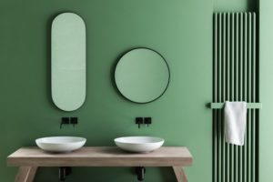 a clean bathroom with green walls